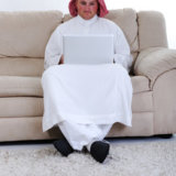 portrait-of-arabic-man-using-laptop-at-home_BtW_giTHs_thumb